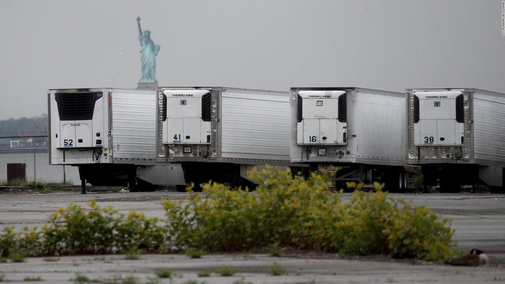 Covid-19 victims, still in refrigerated trucks