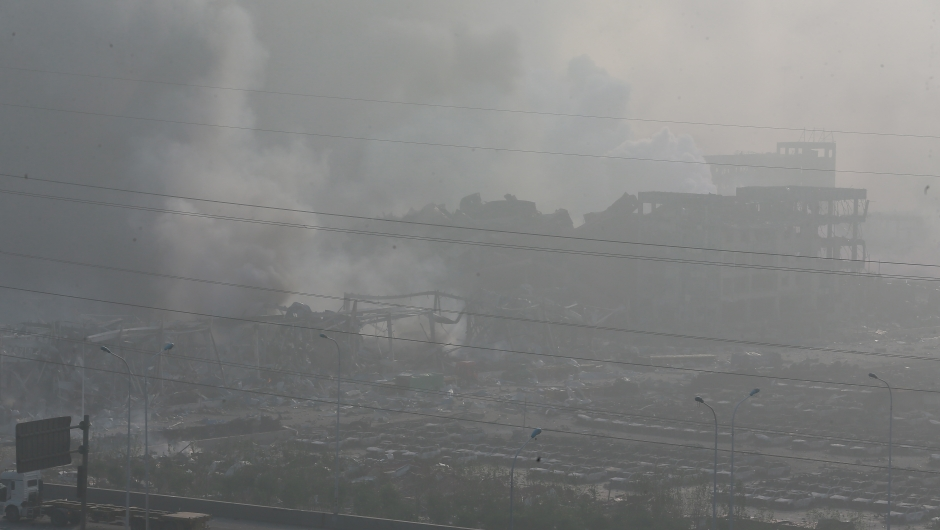 TIANJIN, CHINA - AUGUST 13: (CHINA OUT) Accident site is still smoking after explosions of a warehouse on late Wednesday in Binhai New Area on August 13, 2015 in Tianjin, China. At least 17 people dead, 32 are in critical condition and at least another 400 injured during the explosions of a warehouse on late Wednesday in Binhai New Area in Tianjin, according to police authority. (Photo by ChinaFotoPress/ChinaFotoPress via Getty Images)