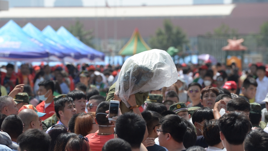 Victims of the massive explosions gather in a temporary shelter at an elementary school in Tianjin on August 13, 2015. Enormous explosions in a major Chinese port city killed at least 44 people and injured more than 500, state media reported on August 13, leaving a devastated industrial landscape of incinerated cars, toppled shipping containers and burnt-out buildings. CHINA OUT AFP PHOTO (Photo credit should read STR/AFP/Getty Images)