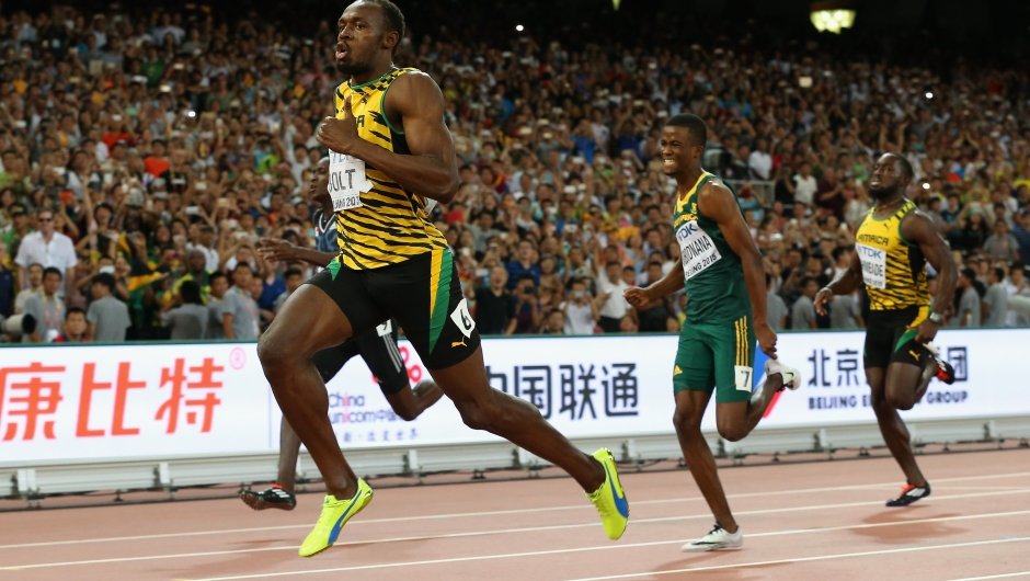 BEIJING, CHINA - AUGUST 27: Usain Bolt of Jamaica crosses the finish line to win gold ahead of Anaso Jobodwana of South Africa (2nd R) in the Men's 200 metres final during day six of the 15th IAAF World Athletics Championships Beijing 2015 at Beijing National Stadium on August 27, 2015 in Beijing, China. (Photo by Andy Lyons/Getty Images)