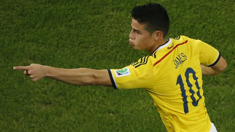Colombia's midfielder James Rodriguez runs as he celebrates his second goal during the Round of 16 football match between Colombia and Uruguay at The Maracana Stadium in Rio de Janeiro on June 28, 2014, during the 2014 FIFA World Cup. AFP PHOTO / FABRIZIO BENSCH/POOL (Photo credit should read FABRIZIO BENSCH/AFP/Getty Images)