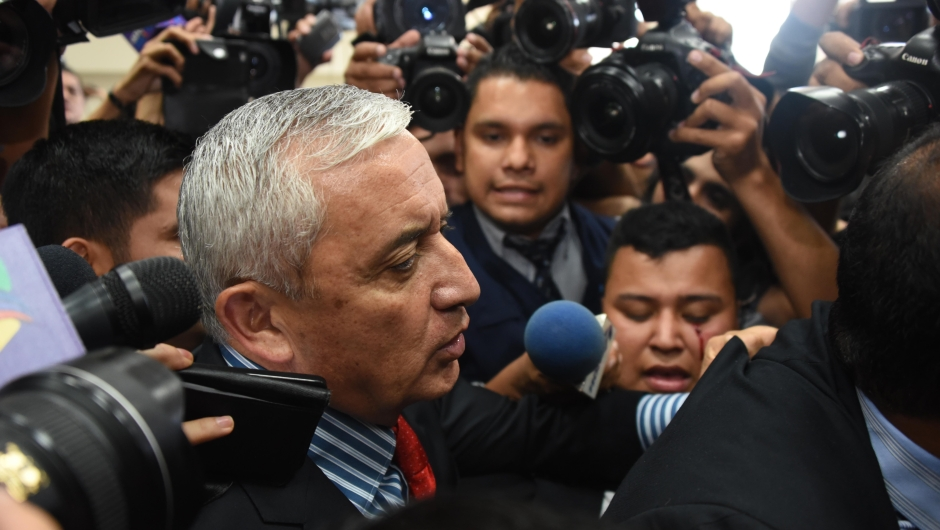 Guatemalan former President Otto Perez arrives at the Tribunal of Justice in Guatemala city on September 3, 2015. Embattled Guatemalan President Otto Perez resigned Thursday after a judge issued a warrant for his arrest to face corruption charges, upending the political landscape three days ahead of general elections. AFP PHOTO / Johan ORDONEZ (Photo credit should read JOHAN ORDONEZ/AFP/Getty Images)