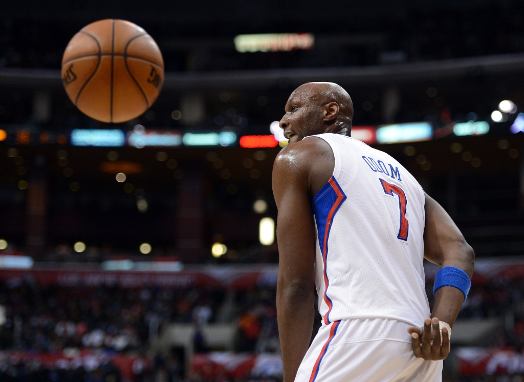 LOS ANGELES, CA - JANUARY 27: Lamar Odom #7 of the Los Angeles Clippers makes a behind the back pass to the referee after a stop in play at Staples Center on January 27, 2013 in Los Angeles, California. NOTE TO USER: User expressly acknowledges and agrees that, by downloading and or using this photograph, User is consenting to the terms and conditions of the Getty Images License Agreement. (Photo by Harry How/Getty Images)