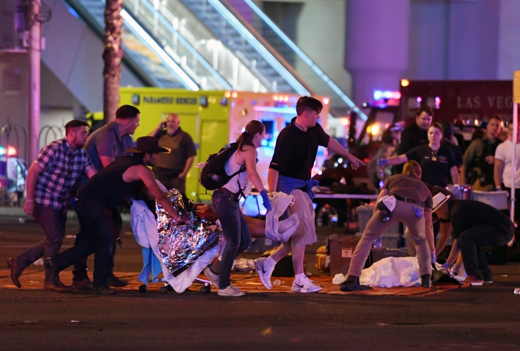 LAS VEGAS, NV - OCTOBER 02: An injured person is tended to in the intersection of Tropicana Ave. and Las Vegas Boulevard after a mass shooting at a country music festival nearby on October 2, 2017 in Las Vegas, Nevada. A gunman has opened fire on a music festival in Las Vegas, killing over 20 people. Police have confirmed that one suspect has been shot dead. The investigation is ongoing. (Photo by Ethan Miller/Getty Images)