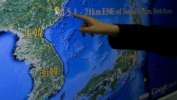 Kuo Kai-wen, director of Taiwan's Seismology Center, points at the locations from a monitor showing North Korea's first hydrogen bomb test site, in Taipei on January 6, 2016. North Korea said it had carried out a 'successful' miniaturised hydrogen bomb test -- a shock announcement that, if confirmed, would massively raise the stakes in the hermit states bid to strengthen its nuclear arsenal. AFP PHOTO / Sam Yeh / AFP / SAM YEH (Photo credit should read SAM YEH/AFP/Getty Images)