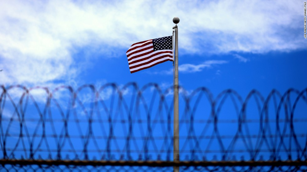 GUANTANAMO BAY, CUBA - JUNE 25: (EDITORS NOTE: Image has been reviewed by the U.S. Military prior to transmission.) An American flag flies over Camp VI the U.S. military prison for 'enemy combatants' on June 25, 2013 in Guantanamo Bay, Cuba. President Barack Obama has recently spoken again about closing the prison which has been used to hold prisoners from the invasion of Afghanistan and the war on terror since early 2002. (Photo by Joe Raedle/Getty Images)