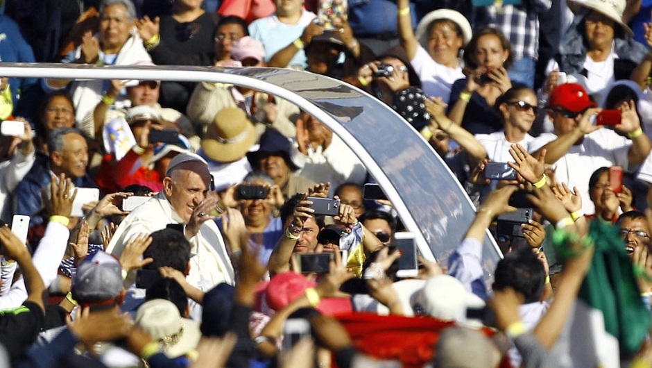 "Pope Francis waves at the crowd from the popemobile on his way to the Guadalupe Basilica in Mexico City on February 13, 2016. Pope Francis urged Mexican bishops Saturday to take on drug trafficking with ""prophetic courage,"" warning that it represents a moral challenge to society and the church. AFP PHOTO / Pedro PARDO / AFP / Pedro PARDO (Photo credit should read PEDRO PARDO/AFP/Getty Images)"