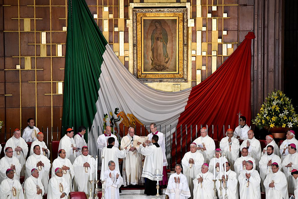 Pope Francis (C) officiates a Holy Mass in the Basilica of Our Lady of Guadalupe in Mexico on February 13, 2016. Pope Francis is in Mexico for a trip encompassing two of the defining themes of his papacy: bridge-building diplomacy and his concern for migrants seeking a better life. AFP PHOTO / GABRIEL BOUYS / AFP / GABRIEL BOUYS (Photo credit should read GABRIEL BOUYS/AFP/Getty Images)