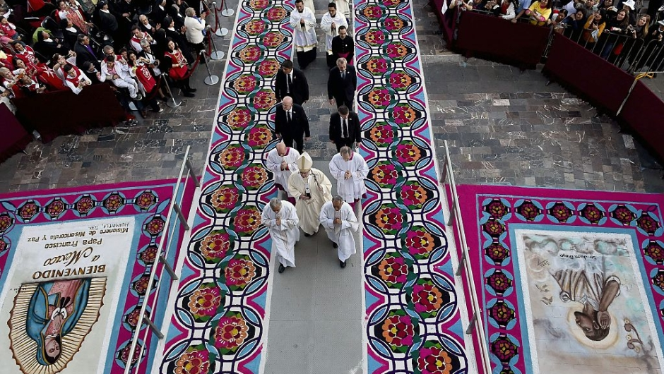 Pope Francis (C) arrives to celebrate a Holy Mass in the Basilica of Our Lady of Guadalupe in Mexico on February 13, 2016. Pope Francis is in Mexico for a trip encompassing two of the defining themes of his papacy: bridge-building diplomacy and his concern for migrants seeking a better life. AFP PHOTO / GABRIEL BOUYS / AFP / GABRIEL BOUYS (Photo credit should read GABRIEL BOUYS/AFP/Getty Images)