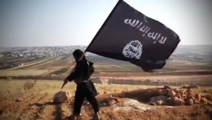 """An image grab taken from a video uploaded on YouTube on August 23, 2013 allegedly shows a member of Ussud Al-Anbar (Anbar Lions), a Jihadist group affiliated to the Islamic State of Iraq and the Levant , Al-Qaeda's front group in Iraq, holding up the trademark black and white Islamist flag at an undisclosed location in Iraq's Anbar province. Attacks in Iraq killed 14 people including six soldiers on August 25, Iraqi officials said, amid a surge in violence authorities have so far failed to stem despite wide-ranging operations targeting militants. Arabic writing on the flag reads: """"There is not God but God and Mohammed is the prophet of God."""" AFP PHOTO / YOUTUBE == RESTRICTED TO EDITORIAL USE - MANDATORY CREDIT """"AFP PHOTO / YOUTUBE """" - NO MARKETING NO ADVERTISING CAMPAIGNS - DISTRIBUTED AS A SERVICE TO CLIENTS FROM FROM ALTERNATIVE SOURCES, THEREFORE AFP IS NOT RESPONSIBLE FOR ANY DIGITAL ALTERATIONS TO THE PICTURE'S EDITORIAL CONTENT, DATE AND LOCATION WHICH CANNOT BE INDEPENDENTLY VERIFIED =="""