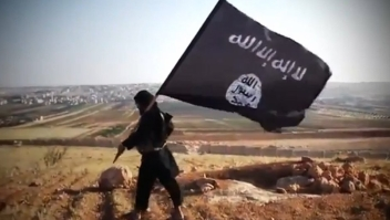 "An image grab taken from a video uploaded on YouTube on August 23, 2013 allegedly shows a member of Ussud Al-Anbar (Anbar Lions), a Jihadist group affiliated to the Islamic State of Iraq and the Levant , Al-Qaeda's front group in Iraq, holding up the trademark black and white Islamist flag at an undisclosed location in Iraq's Anbar province. Attacks in Iraq killed 14 people including six soldiers on August 25, Iraqi officials said, amid a surge in violence authorities have so far failed to stem despite wide-ranging operations targeting militants. Arabic writing on the flag reads: ""There is not God but God and Mohammed is the prophet of God."" AFP PHOTO / YOUTUBE == RESTRICTED TO EDITORIAL USE - MANDATORY CREDIT ""AFP PHOTO / YOUTUBE "" - NO MARKETING NO ADVERTISING CAMPAIGNS - DISTRIBUTED AS A SERVICE TO CLIENTS FROM FROM ALTERNATIVE SOURCES, THEREFORE AFP IS NOT RESPONSIBLE FOR ANY DIGITAL ALTERATIONS TO THE PICTURE'S EDITORIAL CONTENT, DATE AND LOCATION WHICH CANNOT BE INDEPENDENTLY VERIFIED =="
