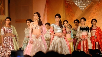 Indian models showcase creations by Manish Malhotra during the 'Regal Threads' charity fashion show in Mumbai on late January 14, 2016. AFP PHOTO / STR / AFP / STRDEL (Photo credit should read STRDEL/AFP/Getty Images)