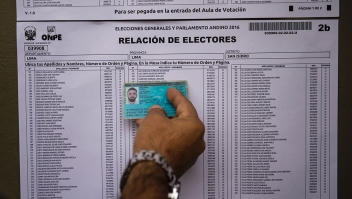 A voter looks for his name in an electoral roll at a polling station during presidential elections in Lima on April 10, 2016. Almost 23 million Peruvians in Peru and abroad are expected to decide whether Keiko Fujimori, daughter of an ex-president jailed for massacres, should become their first female head of state in an election marred by alleged vote-buying and guerrilla attacks that killed four. / AFP / MARTIN BERNETTI (Photo credit should read MARTIN BERNETTI/AFP/Getty Images)