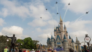 LAKE BUENA VISTA, FL - MARCH 19: In this handout photo provided by Disney Parks, in a special moment for Magic Kingdom guests, the U.S. Navy Flight Demonstration Squadron, the Blue Angels, streaked across the skies above, Cinderella Castle March 19, 2015 at Walt Disney World Resort in Lake Buena Vista, Florida. The flyover featured the Blue Angels' six-jet F/A-18 Hornet Delta Formation making two dramatic passes above the Magic Kingdom, with Cinderella Castle as a focal point, en route to an air show in Florida. (Photo by Mariah Wild/Disney Parks via Getty Images)