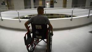 Colombian soldier Edward Avila, who lost both legs when he stepped on a landmine three months ago, while installing a playground in Convencion municipality, North of Santander, heads for his rehabilitation at the Heroes de Paramillo hospital in Medellin, Antioquia department, Colombia, on August 26, 2015. The Colombian government and the FARC guerrillas have recently agreed on a program to remove landmines from the country, one of the most mined ones in the world after Afghanistan and Cambodia. AFP PHOTO/RAUL ARBOLEDA (Photo credit should read RAUL ARBOLEDA/AFP/Getty Images)
