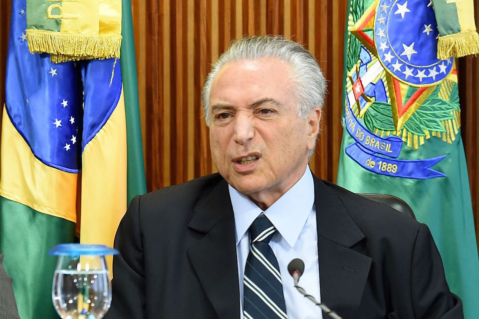Brazilian acting President Michel Temer gestures during the first ministers meeting at the Planalto Palace in Brasilia, on May 13, 2016. Temer kicks off his new administration Friday, seeking to resuscitate the economy and steer clear of the corruption scandal that helped bring down his predecessor. / AFP / EVARISTO SA        (Photo credit should read EVARISTO SA/AFP/Getty Images)