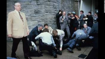23374 08: Chaos Surrounds Shooting Victims Immediately After The Assassination Attempt On President Reagan, March 30, 1981, By John Hinkley Jr. Outside The Hilton Hotel In Washington, Dc. Injured In The Shooting Are Press Secretary James Brady And Agent Timothy Mccarthy. (Photo By Dirck Halstead/Getty Images)
