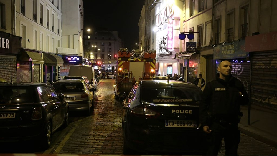 Police secure the area following an attack in the 10th arrondissement of the French capital Paris, on November 13, 2015. At least 18 people were killed as multiple shootings and explosions hit Paris, police said. Police also said there was an ongoing hostage crisis in the Bataclan a concert hall in the French capital. AFP PHOTO / KENZO TRIBOUILLARD (Photo credit should read KENZO TRIBOUILLARD/AFP/Getty Images)