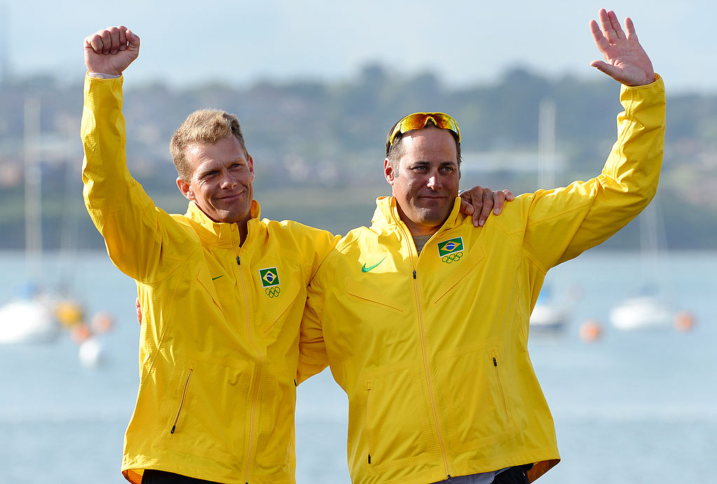 Bronze medalists Brazil's Bruno Prada (L) and Robert Scheidt celebrate on the podium of the Star sailing class at the London 2012 Olympic Games, in Weymouth on August 5, 2012. AFP PHOTO/William WEST (Photo credit should read WILLIAM WEST/AFP/GettyImages)