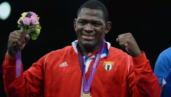 Gold Medalist Cuban Mijain Lopez Nunez poses for a photograph on the podium during the medal ceremony of the men's 120 kg greco roman style at the London 2012 Olympic Games in London on August 6, 2012. AFP PHOTO /ADEK BERRY (Photo credit should read ADEK BERRY/AFP/GettyImages)