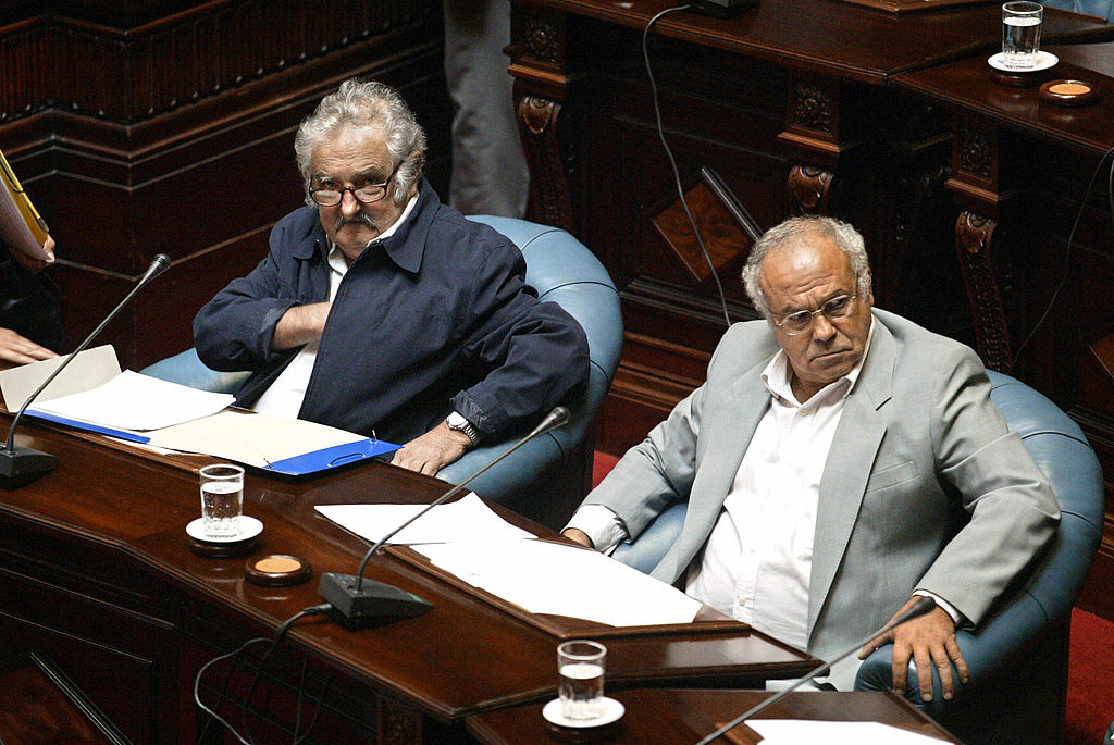 MONTEVIDEO, URUGUAY: The President of the new Uruguayan Senate, Jose Mujica (L) and senator Eleuterio Fernandez Huidobro, former guerrilla leaders of the leftist MLN-Tupamaros, who both spent 14 years in jail during the dictatorship (1973-1985) in Uruguay, take part in the Opening of the 46th session of the Parliament, 15 February 2005 in Montevideo. The two were the most voted in the general elections the past 31 October, when the candidate of the leftist coalition, Tabare Vazquez, was elected President. AFP PHOTO/Miguel ROJO (Photo credit should read