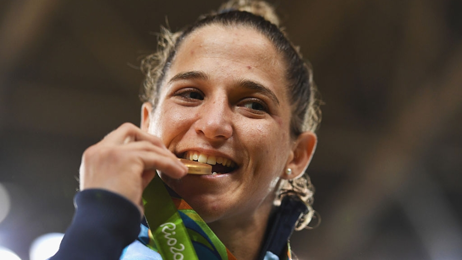 RIO DE JANEIRO, BRAZIL - AUGUST 06: Paula Pareto of Argentina celebrates winning the gold medal in the Women's -48 kg Judo on Day 1 of the Rio 2016 Olympic Games at Carioca Arena 2 on August 6, 2016 in Rio de Janeiro, Brazil. (Photo by Laurence Griffiths/Getty Images)