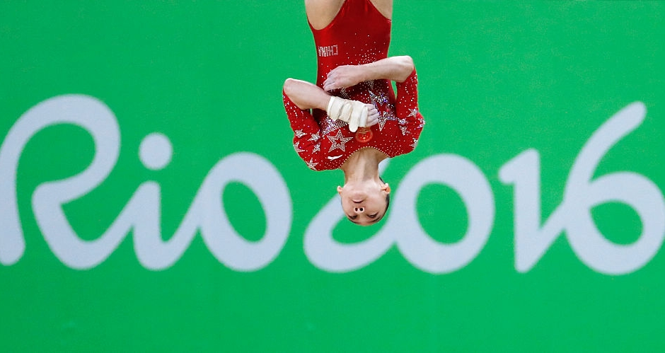 China's Fan Yilin competes in the qualifying for the women's Floor event of the Artistic Gymnastics at the Olympic Arena during the Rio 2016 Olympic Games in Rio de Janeiro on August 7, 2016. / AFP / Thomas COEX (Photo credit should read THOMAS COEX/AFP/Getty Images)
