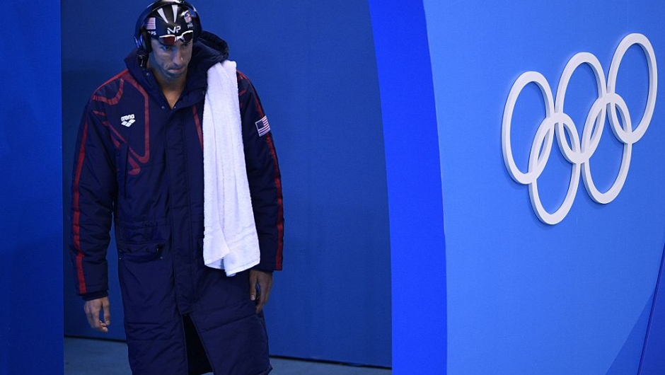 USA's Michael Phelps arrives to compete in the Men's 200m Butterfly Semifinal during the swimming event at the Rio 2016 Olympic Games at the Olympic Aquatics Stadium in Rio de Janeiro on August 8, 2016. / AFP / Martin BUREAU (Photo credit should read MARTIN BUREAU/AFP/Getty Images)