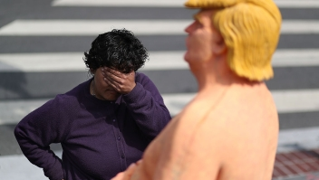 SAN FRANCISCO, CA - AUGUST 18: A passerby looks at a statue depicting republican presidential nominee Donald Trump in the nude on August 18, 2016 in San Francisco, United States. Anarchist collective INDECLINE has created five statues depicting Donald Trump in the nude and placed them in five U.S. cities on Thursday morning. The statues are in San Francisco, New York, Los Angeles, Cleveland and Seattle. (Photo by Justin Sullivan/Getty Images)