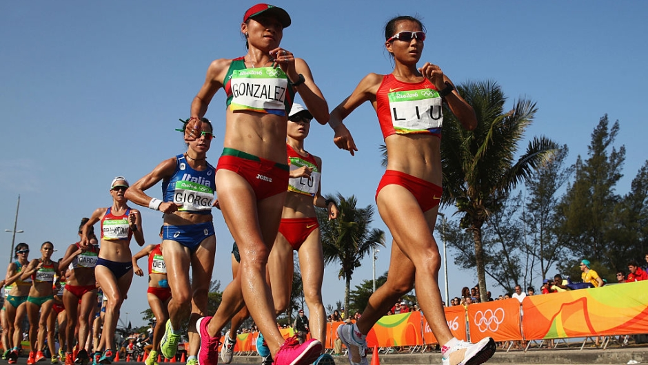 RIO DE JANEIRO, BRAZIL - AUGUST 19: Maria Guadalupe Gonzalez of Mexico and Hong Liu of China lead the group as they compete in the Women's 20km Walk final on Day 14 of the Rio 2016 Olympic Games at Pontal on August 19, 2016 in Rio de Janeiro, Brazil. (Photo by Julian Finney/Getty Images)