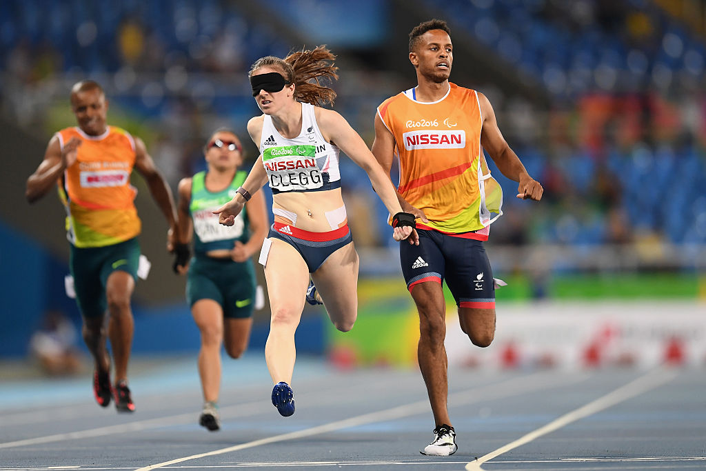 RIO DE JANEIRO, BRAZIL - SEPTEMBER 12: Libby Clegg of Great Britain competes in the Women's 200m - T11 semi final on day 5 of the Rio 2016 Paralympic Games at the Olympic Stadium on September 12, 2016 in Rio de Janeiro, Brazil. (Photo by Atsushi Tomura/Getty Images for Tokyo 2020)