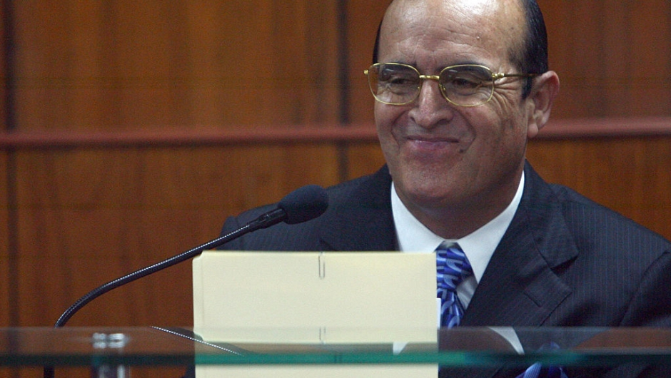 eruvian former President Alberto Fujimori's assistant Vladimiro Montesinos smiles at Fujimori (not in frame) during a hearing of the trial against Fujimori for charges of human rights violations, before the Special Court of the Peruvian Supreme Court on June 30, 2008 in Lima. Fujimori, 69, faces up to 30 years in prison and the payment of 33 million dollars in damages if he is found guilty of human rights violations. AFP PHOTO / JAIME RAZURI (Photo credit should read JAIME RAZURI/AFP/Getty Images)