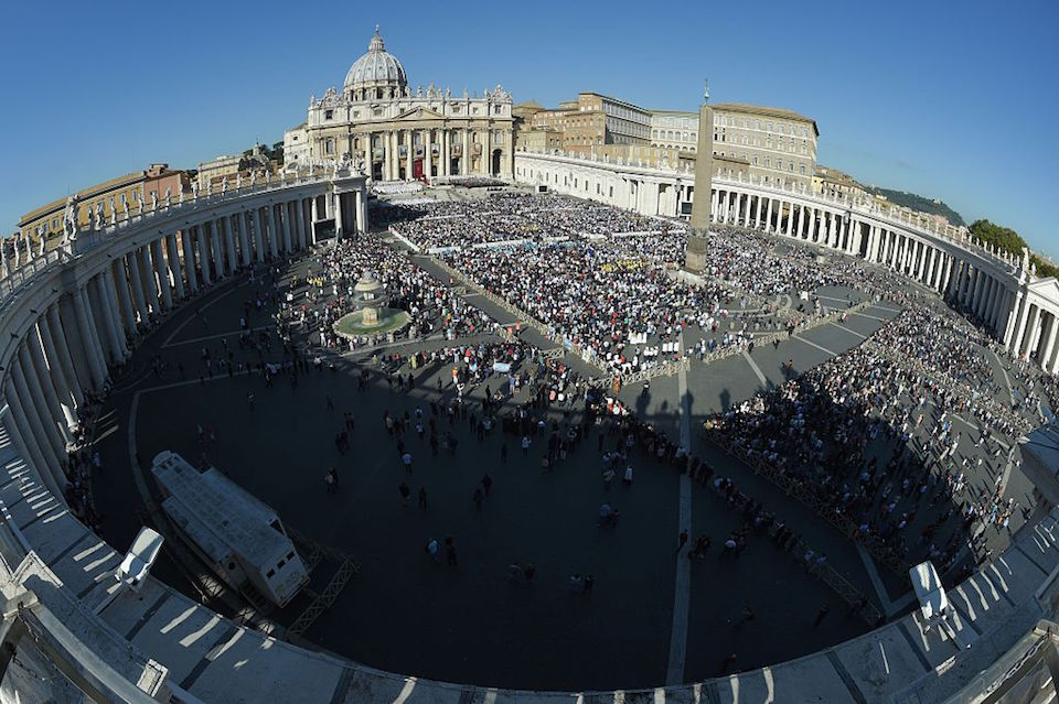 """A general view shows St Peter's square and St Peter's basilica during a canonization mass led by Pope Francis on October 16, 2016 in Vatican. Pope Francis canonises Argentine """"gaucho priest"""" Jose Gabriel Brochero today along with six others raised to sainthood : Salomon Leclercq, Jose Sanchez del Río, Manuel Gonzalez Garcia, Lodovico Pavoni, Alfonso Maria Fusco and Elizabeth of the Trinity. Jose Gabriel del Rosario Brochero, born 1849 in the province of Cordoba, spent his days ministering to the poor and the sick, travelling the region on the back of a mule, and building church schools. / AFP / ANDREAS SOLARO (Photo credit should read ANDREAS SOLARO/AFP/Getty Images)"""