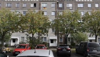 This picture shows the flat (Up Center R) on the last floor of a communist-era housing block in Leipzig Paunsdorf, eastern Germany, where a Syrian man, suspected of plotting a jihadist bomb attack, has been arrested on October 10, 2016. The Syrian man was arrested with the help of two of the fugitive's compatriots, in a case that sparked fresh calls for greater checks on asylum seekers. / AFP / John MACDOUGALL (Photo credit should read JOHN MACDOUGALL/AFP/Getty Images)