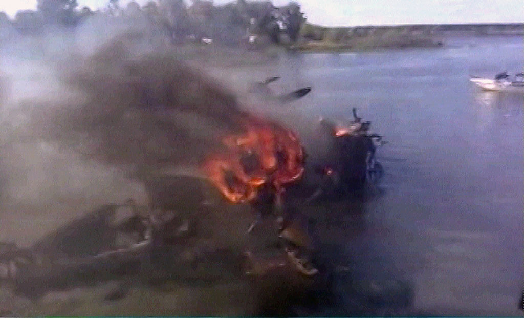 TV grab from Russian NTV channel showing burning remains of a plane at a crash site outside Yaroslavl airport on September 7, 2011 some 300 kilometres (185 miles) northeast of Moscow . At least 44 people were killed September 7, 2011 when a Russian jet carrying hockey players of Lokomotiv Yaroslavl to their first match of the KHL (Kontinental Hockey League) season crashed on takeoff in the latest blow to the country's tainted air safety record. AFP PHOTO/ NTV (Photo credit should read ALEXANDER NEMENOV/AFP/Getty Images)