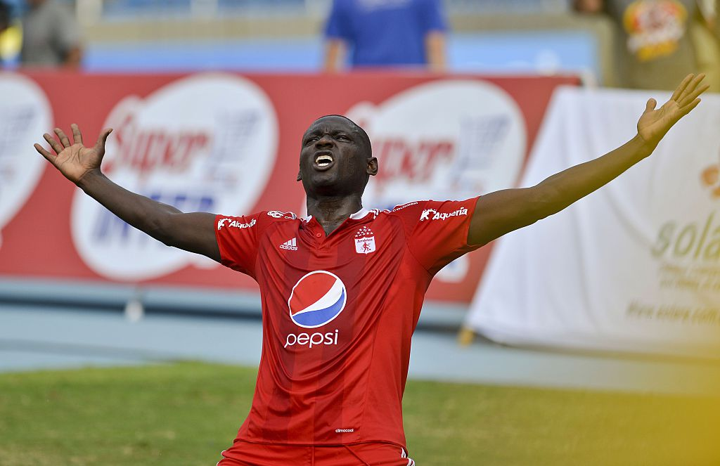 America de Cali's Cristian Martinez celebrates his goal scores over Deportes Quindio during a Colombian Professional Football tournament promotion match in Cali, Colombia, on November 27, 2016.  America de Cali defeated Deportes Quindio by 2-1 and returned to first division after five years. / AFP / LUIS ROBAYO        (Photo credit should read LUIS ROBAYO/AFP/Getty Images)
