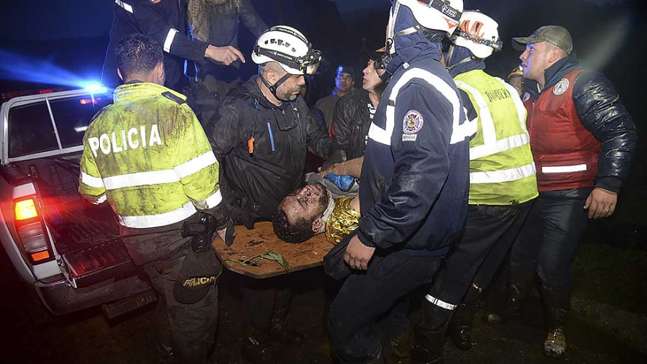 Rescuers carry one of the survivors from the LAMIA airlines charter plane carrying members of the Chapecoense Real football team that crashed in the mountains of Cerro Gordo, municipality of La Union, on November 29, 2016. A charter plane carrying the Brazilian football team crashed in the mountains in Colombia late Monday, killing as many as 75 people, officials said. / AFP / Raul ARBOLEDA (Photo credit should read RAUL ARBOLEDA/AFP/Getty Images)