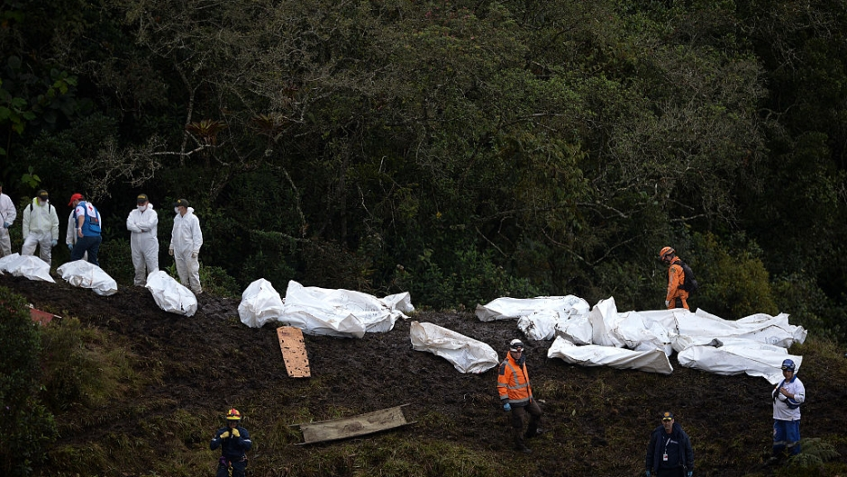 Rescue and forensic teams recover the bodies of victims of the LAMIA airlines charter that crashed in the mountains of Cerro Gordo, municipality of La Union, Colombia, on November 29, 2016 carrying members of the Brazilian football team Chapecoense Real. A charter plane carrying the Brazilian football team crashed in the mountains in Colombia late Monday, killing as many as 75 people, officials said. / AFP / STR / Raul ARBOLEDA (RAUL ARBOLEDA/AFP/Getty Images)