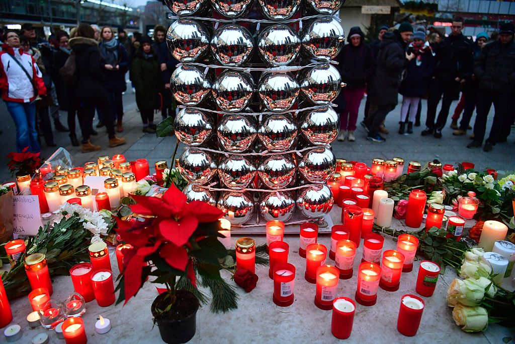 Candles are lit on December 20, 2016 at a makeshift memorial in front of the Kaiser-Wilhelm-Gedaechtniskirche (Kaiser Wilhelm Memorial Church) in Berlin, where a truck crashed the day before into a Christmas market. Twelve people were killed and almost 50 wounded, 18 seriously, when the lorry tore through the crowd on December 19, 2016, smashing wooden stalls and crushing victims, in scenes reminiscent of July's deadly attack in the French Riviera city of Nice. / AFP / John MACDOUGALL (Photo credit should read JOHN MACDOUGALL/AFP/Getty Images)