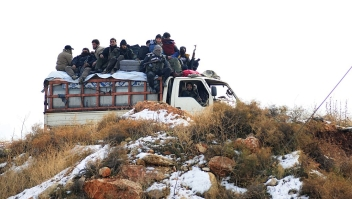 Syrian rebel fighters, are evacuated from Aleppo towards rebel-held territory in the west of Aleppo's province on December 22, 2016. / AFP / YOUSSEF KARWASHAN (Photo credit should read YOUSSEF KARWASHAN/AFP/Getty Images)