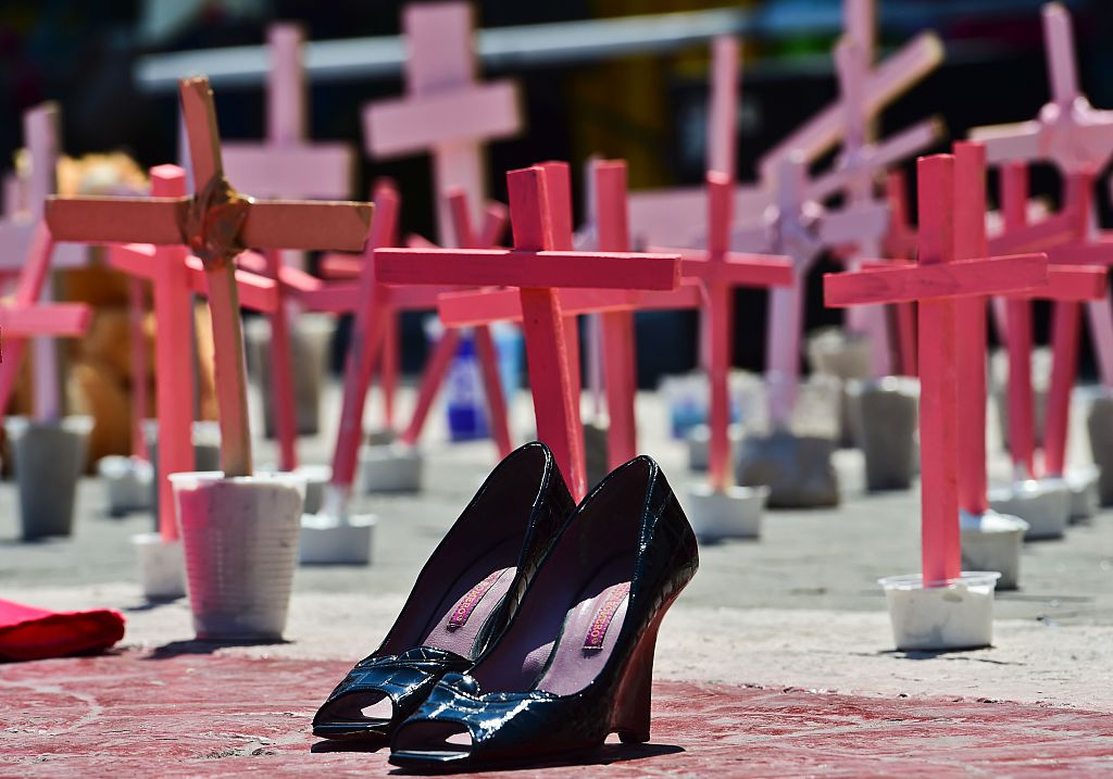 High-heeled shoes from a victim of femicide are pictured next to crosses during a protest against the murder of more than 600 women in the last four years, in Ecatepec, State of Mexico, on March 13 , 2016. AFP PHOTO/RONALDO SCHEMIDT / AFP / RONALDO SCHEMIDT (Photo credit should read RONALDO SCHEMIDT/AFP/Getty Images)