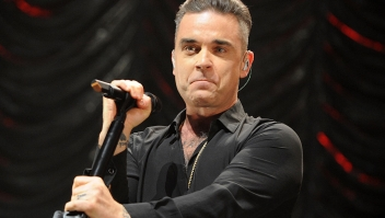 MANCHESTER, ENGLAND - DECEMBER 09: Robbie Williams performs on stage at Key 103 Christmas Live at Manchester Arena on December 9, 2016 in Manchester, England. (Photo by Shirlaine Forrest/Getty Images)