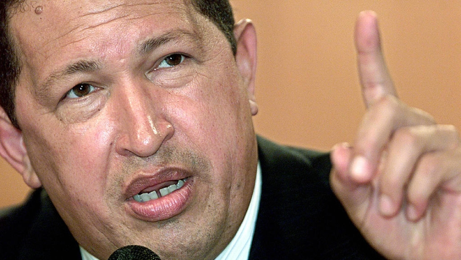 "CARACAS, VENEZUELA: (FILES) Picture of Venezuelan President Hugo Chavez taken in Caracas, 13 February 2004. Mexican authorities accused Venezuela 15 November 2005 of becoming a major new transit point for illegal heroin trafficking, heightening a war of words after the withdrawal of their ambassadors. Venezuela angrily rejected Mexico's demand that it apologize for statements by Chavez, who has called the Mexican president ""a lapdog"" of the United States. The row started after Fox criticized Chavez's stance at last week's Summit of the Americas in Argentina. AFP PHOTO/Andrew ALVAREZ (Photo credit should read ANDREW ALVAREZ/AFP/Getty Images)"