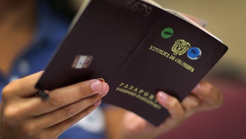 PEMBROKE PINES, FL - SEPTEMBER 15: Constanza Andrade looks at her Colombia passport as she fills out citizenship paper work at a Florida New American Citizenship Clinic on September 15, 2012 in Pembroke Pines, Florida. The clinic put on by the Florida Immigrant Coalition hoped to help up to 100 legal permanent residents get their citizenship paperwork in order and had picked the spot due to what they say are high concentration of immigrant communities in the area who may not have resources or access to information and assistance to become Citizens. (Photo by Joe Raedle/Getty Images)