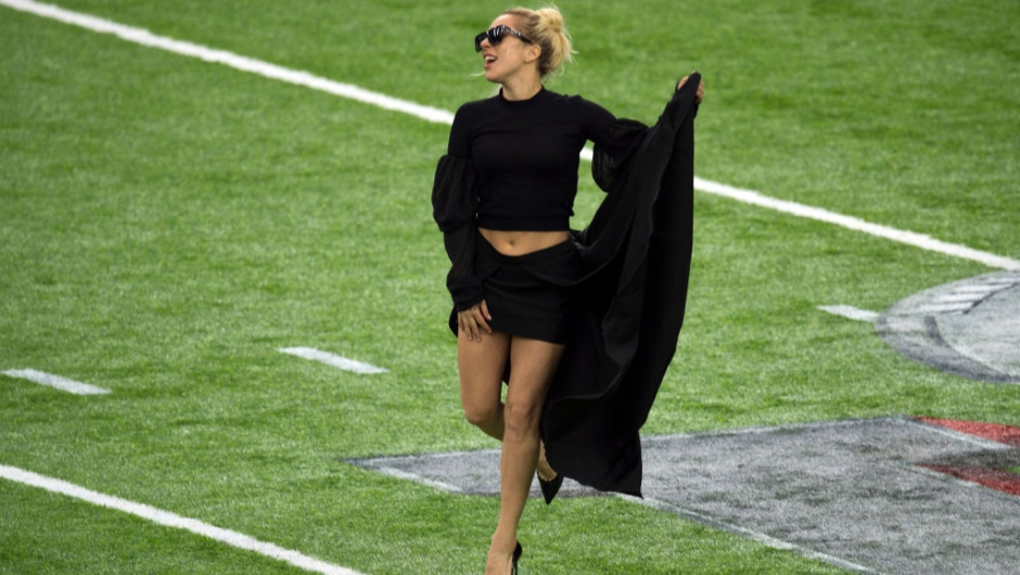 Singer Lady Gaga poses on the field at the Super Bowl LI before the start of the game at Houston NRG Stadium in Houston, Texas, on February 5, 2017. / AFP / VALERIE MACON (Photo credit should read VALERIE MACON/AFP/Getty Images)