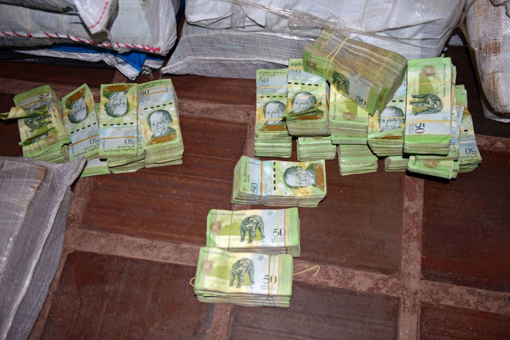 """Picture of 50-Venezuelan Bolivar bills, part of a hoard weighing about 30 tons seized by Paraguay's National Police at a house in Salto del Guaira, department of Canindeyu in the border with Brazil, about 420 km east of Asuncion, on February 14, 2017. In January Venezuela released new bigger denomination banknotes as President Nicolas Maduro wanted to scrap the 100-bolivar note, claiming they are being hoarded by """"mafias."""" / AFP / STR        (Photo credit should read STR/AFP/Getty Images)"""