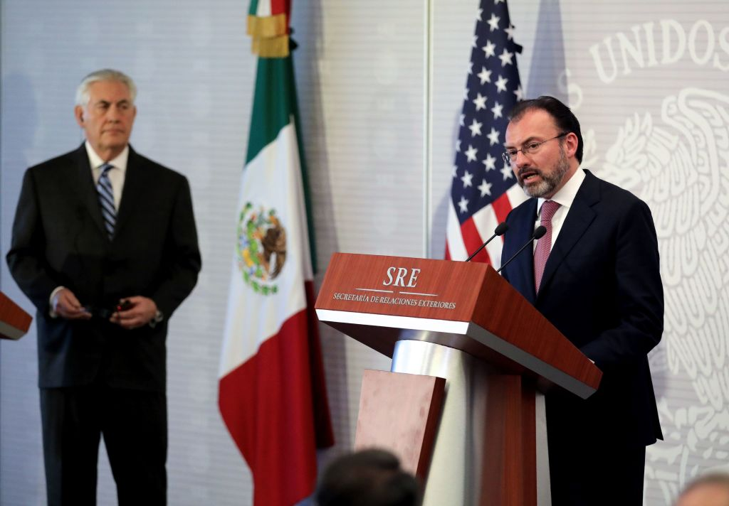 US Secretary of State Rex Tillerson (L) listens to Mexican Foreign Minister Luis Videgaray as they offer a joint press conference at the Foreign Ministry building in Mexico City on February 23, 2017. Mexico vowed not to let the United States impose migration reforms on it as its leaders prepared Thursday to host US officials Tillerson and Homeland Security chief John Kelly who are cracking down on illegal immigrants. / AFP / POOL / Carlos BARRIA (Photo credit should read CARLOS BARRIA/AFP/Getty Images)
