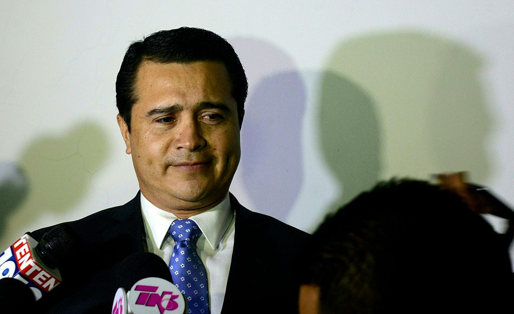 The brother of Honduran President Juan Orlando Hernandez and deputy for the ruling Partido Nacional de Honduras, Juan Antonio Hernandez prepares to speak with the press upon arrival at the Toncontin international airport from the United States, on October 25, 2016 in Tegucigalpa. Earlier this month, Honduran army captain Santos Rodriguez Orellana accused the US Drug Enforcement Administration (DEA) of pressuring him to implicate Hernandez of involvement in a plan to kill the US ambassador, whilst the US is investigating Orellana for alleged corruption and ties to drugs gangs. President Hernandez pledged not to support his brother if it turns out the army captain is involved in drug-related crime as alleged. / AFP / ORLANDO SIERRA (Photo credit should read ORLANDO SIERRA/AFP/Getty Images)