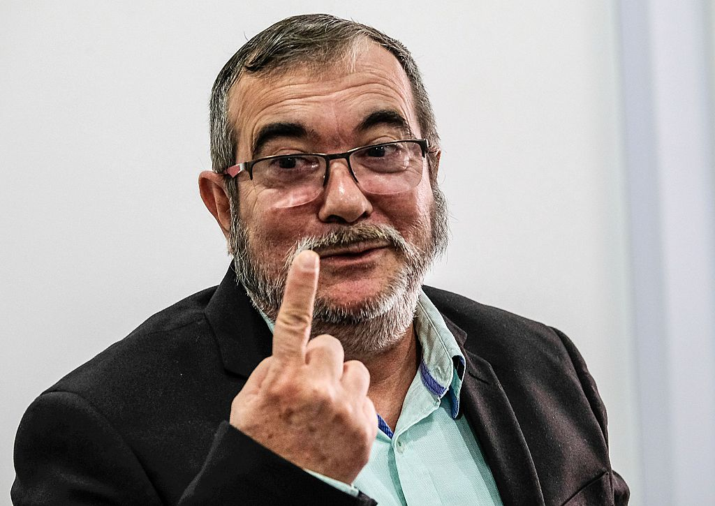 The head of the FARC guerrilla Timoleon Jimenez, aka Timochenko, gestures during a press conference in Bogota on November 25, 2016. Colombia's government and FARC rebels signed a controversial revised peace accord Thursday to end their half-century conflict, set to be ratified in Congress despite bitter opposition. / AFP / Juan Jose Horta (Photo credit should read JUAN JOSE HORTA/AFP/Getty Images)