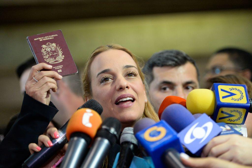 The wife of jailed Venezuelan opposition leader Leopoldo Lopez, Lilian Tintori talks to the media upon her arrival at the Simon Bolivar International Airport from the United States, in Maiquetia, Venezuela on February 16, 2017. Venezuela's Supreme Court on Thursday upheld opposition leader Leopoldo Lopez's nearly 14-year prison sentence, a day after US President Donald Trump called for his release. / AFP / FEDERICO PARRA (Photo credit should read FEDERICO PARRA/AFP/Getty Images)